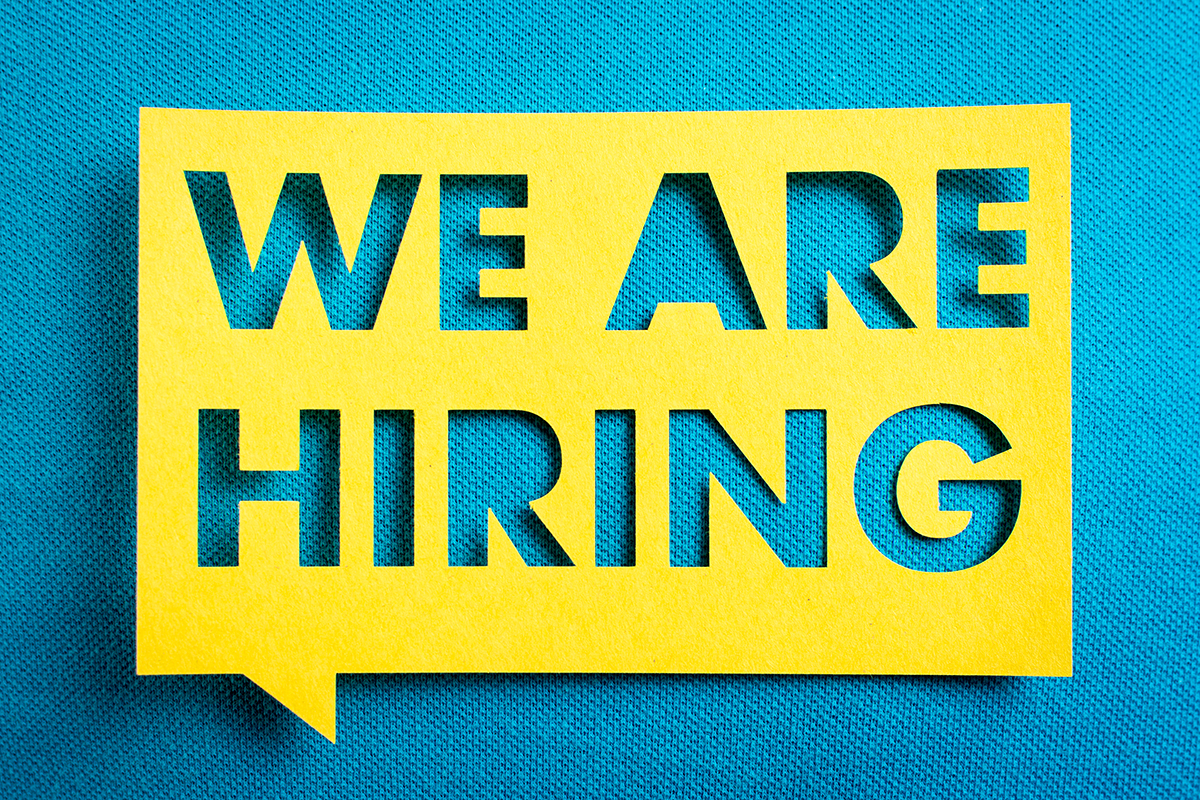 "Concept of recruitment and job search. ""We are hiring"" yellow banner on blue textured background. Job board design, template."