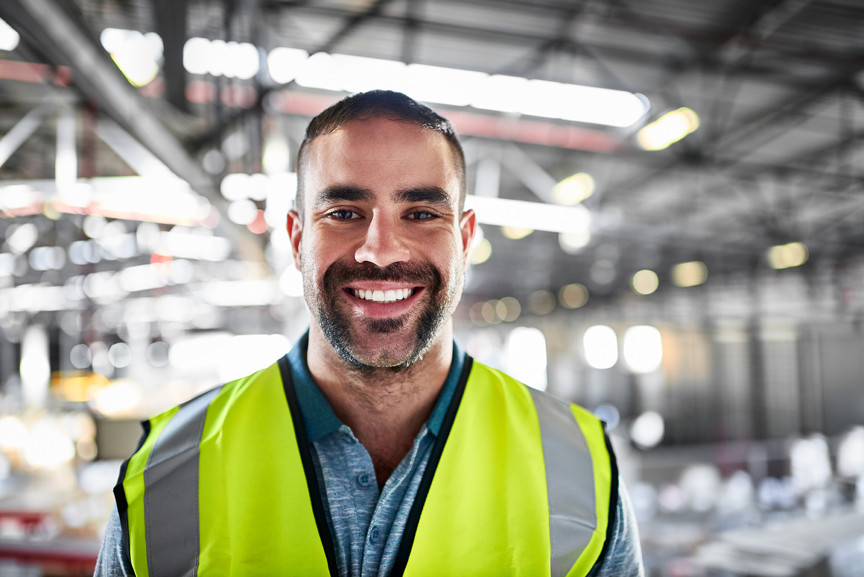 Portrait of a warehouse worker standing in a large warehouse
